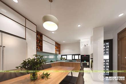 NHÀ PHỐ KẾT HỢP VĂN PHÒNG:  Tủ bếp by UK DESIGN STUDIO - KIẾN TRÚC UK