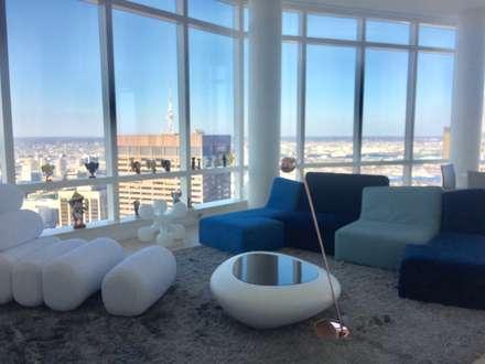 Grand Residence: Salas de estilo ecléctico por Studio ARI