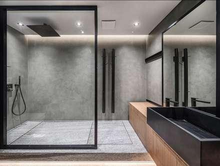 Baños de estilo tropical por Athrva architect
