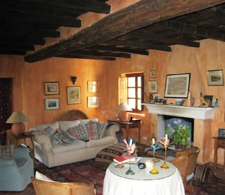 Casa Anne: Salones de estilo rural de Mirasur Proyectos S.L.