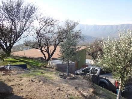 FACHADA SUR: Casas unifamiliares de estilo  por ARKITEKTURA