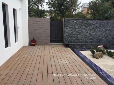Casas unifamiliares de estilo  por 新綠境實業有限公司