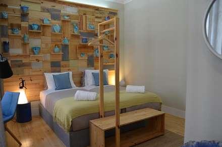 Quarto Cládia Canas: Hotéis  por Natural Craft - Handmade Furniture