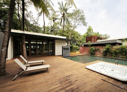 The Portal House: modern Pool by Reasoning Instincts Architecture Studio