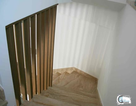 Pasamanos en madera: Escaleras de estilo  de Almacén de Carpintería Gómez