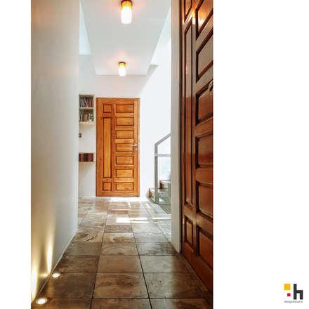 Urban Eclectic Home:  Corridor & hallway by designhood