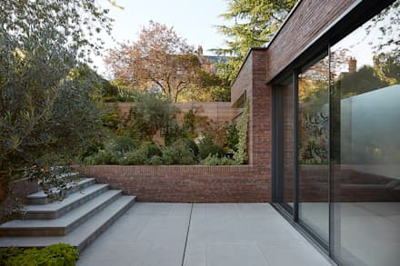 New extension terrace area:  Detached home by Patalab Architecture