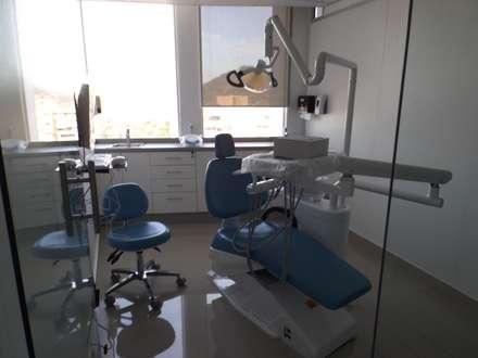 box dental : Estudios y biblioteca de estilo  por Arqsol