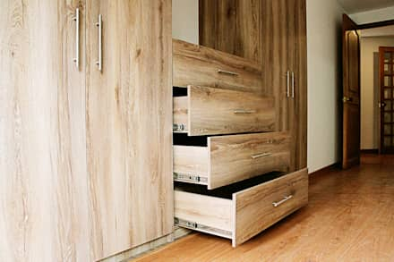 REMODELACION APARTAMENTO ROSALES : Habitaciones de estilo moderno por DECORER