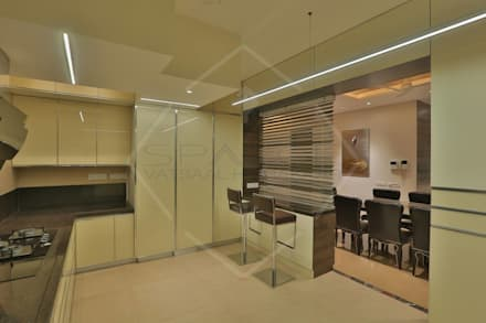 'out of the 'blue' '...an expression in modern interiors:  Built-in kitchens by SPACCE INTERIORS