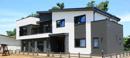 주택 외부: 더존하우징의  목조 주택
