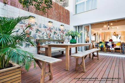 Vivienda particular: Terrazas de estilo  de Lyte Iluminacion