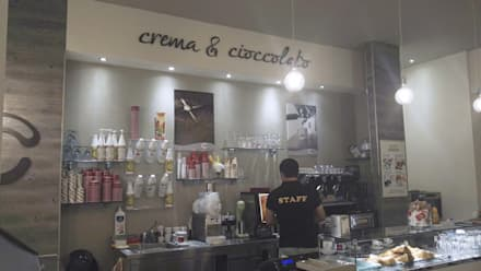 Bar Gelateria - Cinisello Balsamo: Bar & Club in stile  di Architetto Libero Professionista