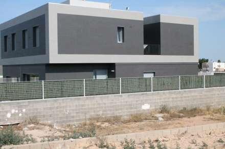 Reforma de una casa unifamiliar en Algemesí: Casas unifamilares de estilo  de miguel cosín