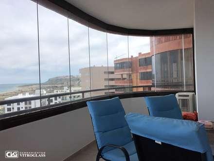 Cortinas de cristal, trabajos realizados en Alicante: Estudios y despachos de estilo moderno de Cerramientos Vitroglass S.L