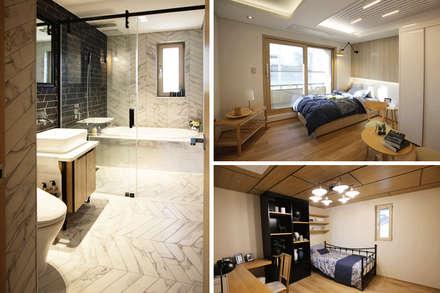 2F 가족룸&개인 공간: 더존하우징의  침실