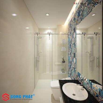 Màu sắc và hoạt tiết trên gạch bông tạo ra sự hút mắt trong căn phòng.:  Phòng tắm by Công ty TNHH Thiết Kế Xây Dựng Song Phát