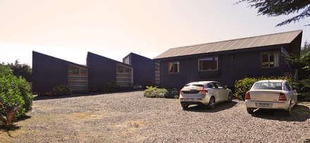 Casas unifamilares de estilo  de m2 estudio arquitectos