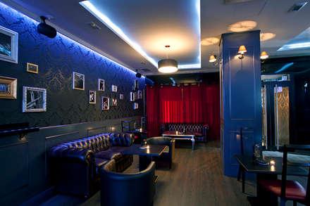 Decoración sala del bar con los sofás chester: Bares y Clubs de estilo  de Muka Design Lab