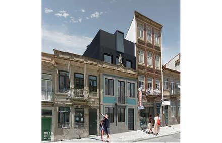Portinho residence: Habitações multifamiliares  por OGGOstudioarchitects, unipessoal lda
