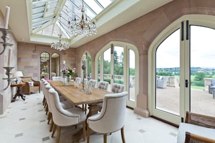 A striking solid construction orangery featuring doors with bronze inserts.: modern Conservatory by Vale Garden Houses