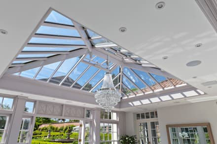 Twin roof lantern orangery homes a luxury kitchen: classic Conservatory by Vale Garden Houses