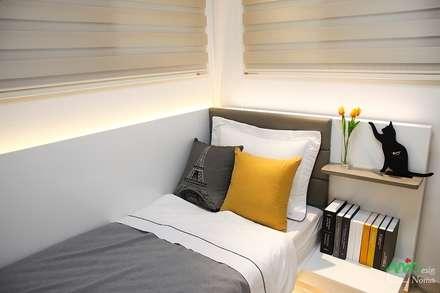 부산 모델하우스 세팅, 편안하면서 세련된 모던스타일 - 노마드디자인: 노마드디자인 / Nomad design의  여아 침실