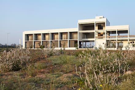 Casas ecológicas de estilo  por DCOOP ARCHITECTS