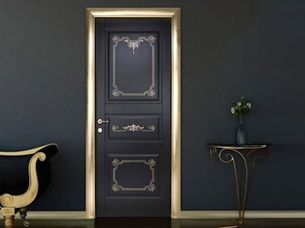 Puertas de entrada de estilo  por كاسل للإستشارات الهندسية وأعمال الديكور في القاهرة