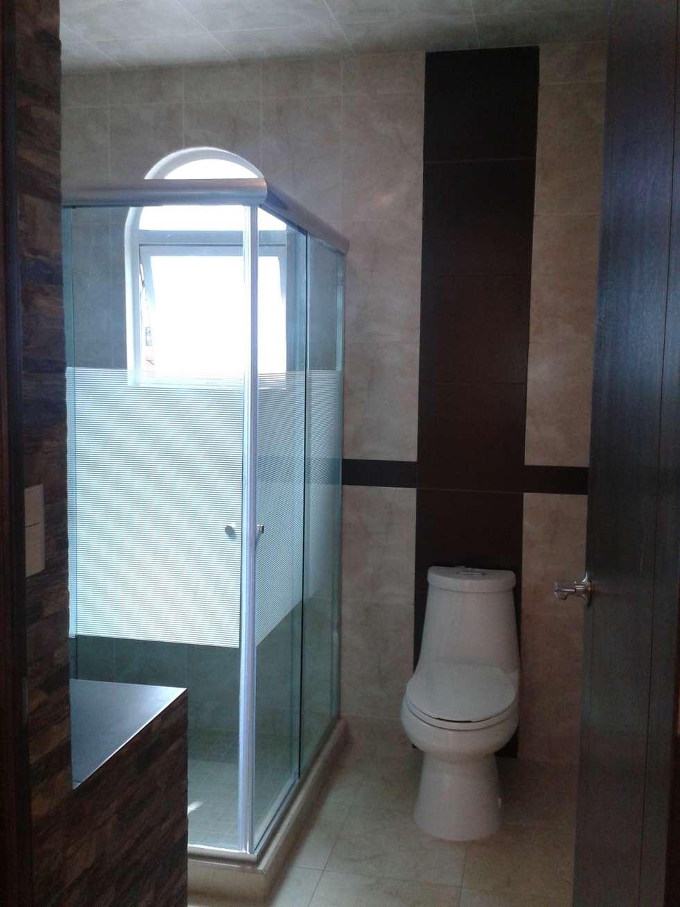 Baño comun: Baños de estilo  por DD Arquitectos