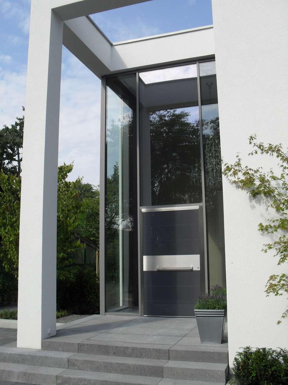 Casas de estilo minimalista por Architekturbüro Sauer-Scholta