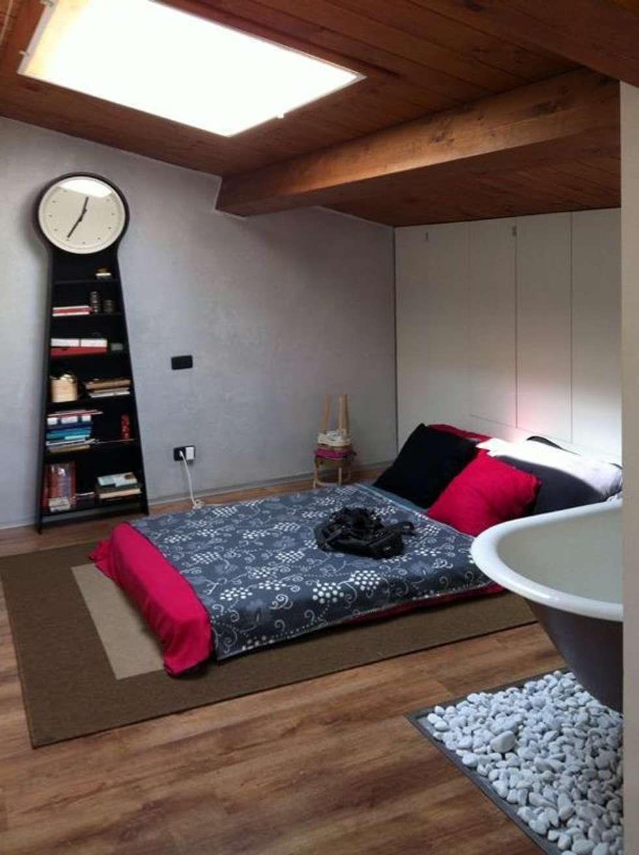 Il letto: Camera da letto in stile in stile Moderno di Spazio 14 10 di Stella Passerini