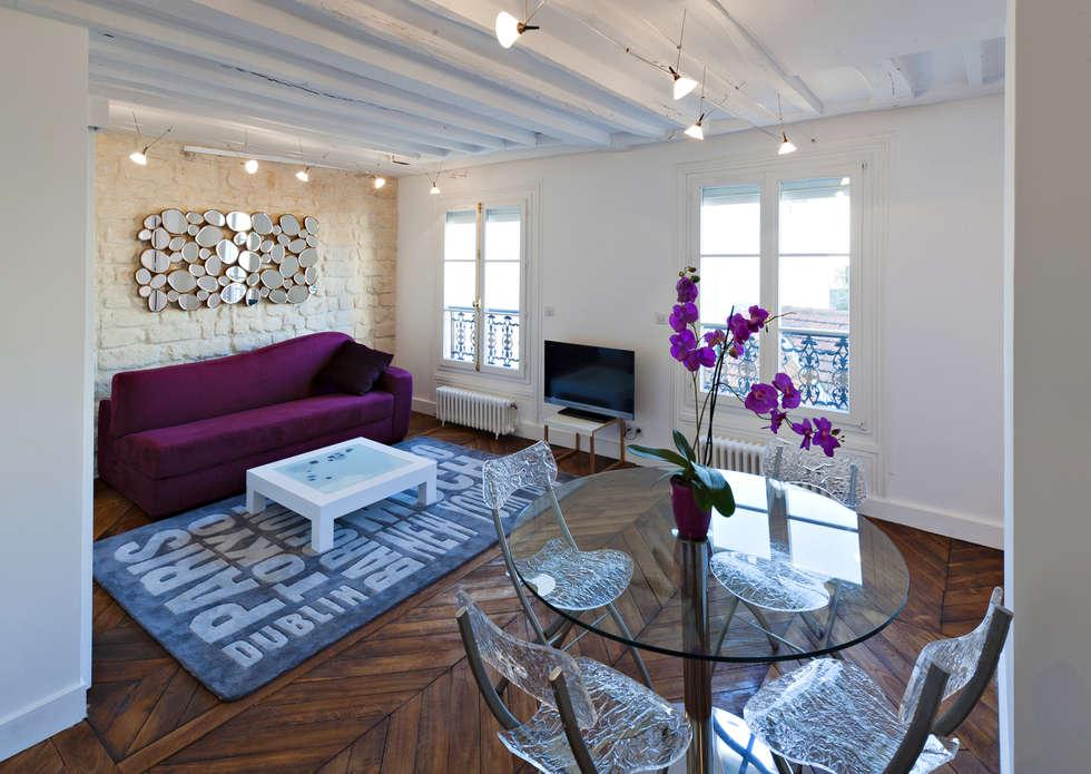 Mobilier contemporain dans un appartement classique: Salle à manger de style de style Classique par Fables de murs