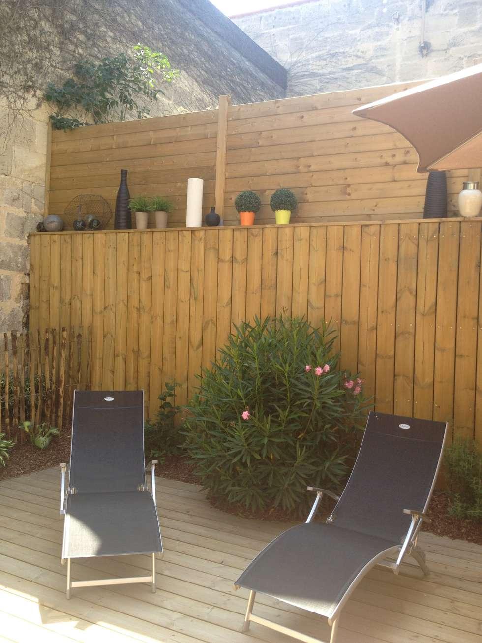 Echoppe Bordelaise: Jardin d'hiver de style  par AUDE SWEET HOME