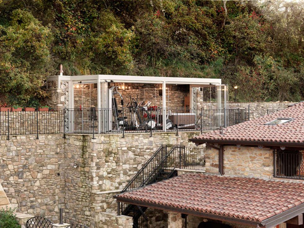 veranda FORMENTERA di CAGIS: Terrazza in stile  di Cagis