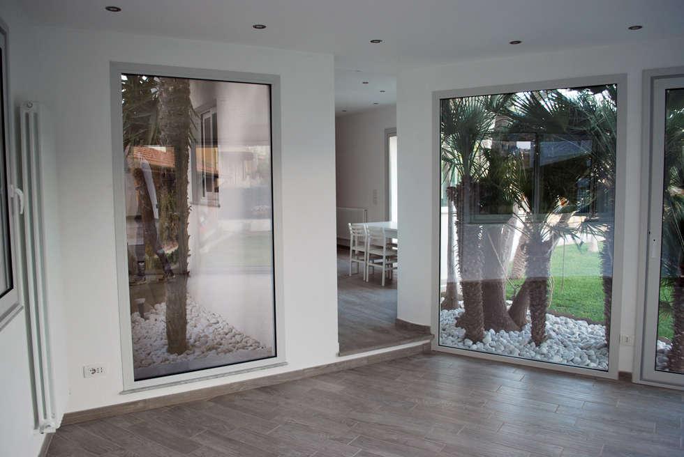 living - kitchen: Giardino d'inverno in stile in stile Moderno di 'ArchIM&DE Project' - Arch. Vincenzo Di Natale -