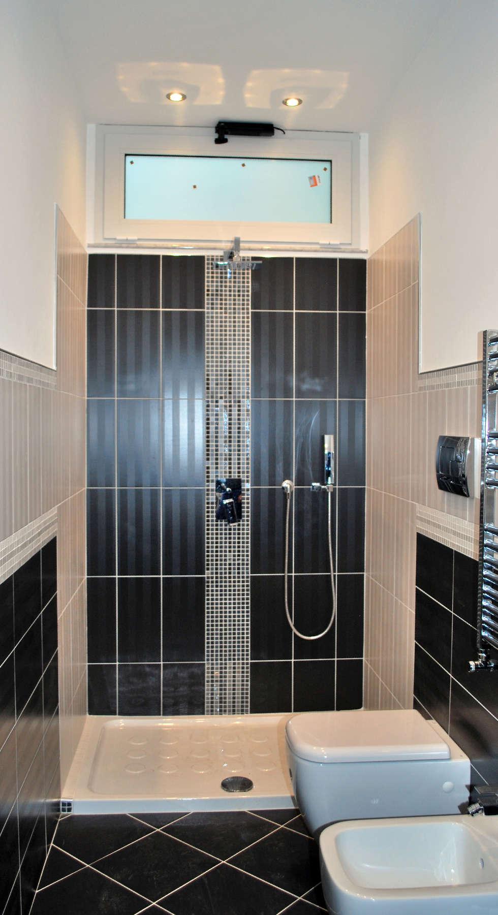 bathroom: Bagno in stile in stile Moderno di 'ArchIM&DE Project' - Arch. Vincenzo Di Natale -
