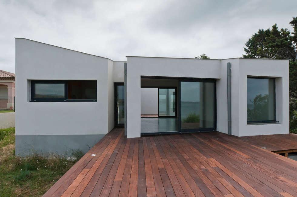Façade Ouest: Maisons de style de style Minimaliste par Frédéric Saint-cricq Architecte