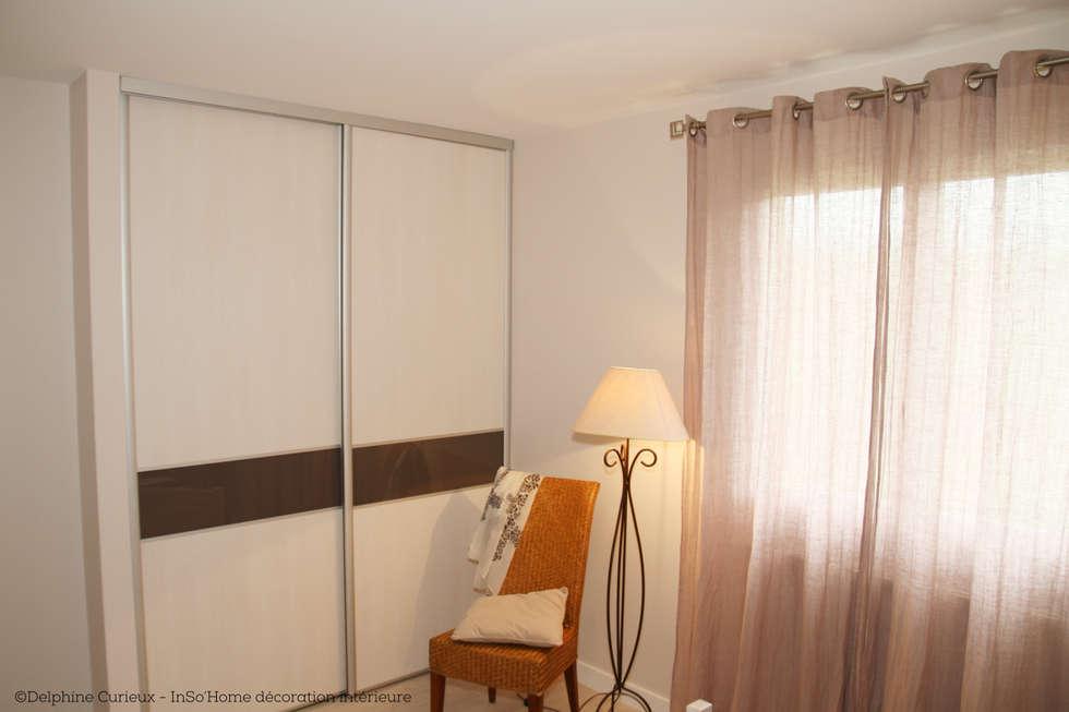 Dressing: Chambre de style de style Classique par INSO'HOME Décoration Intérieure