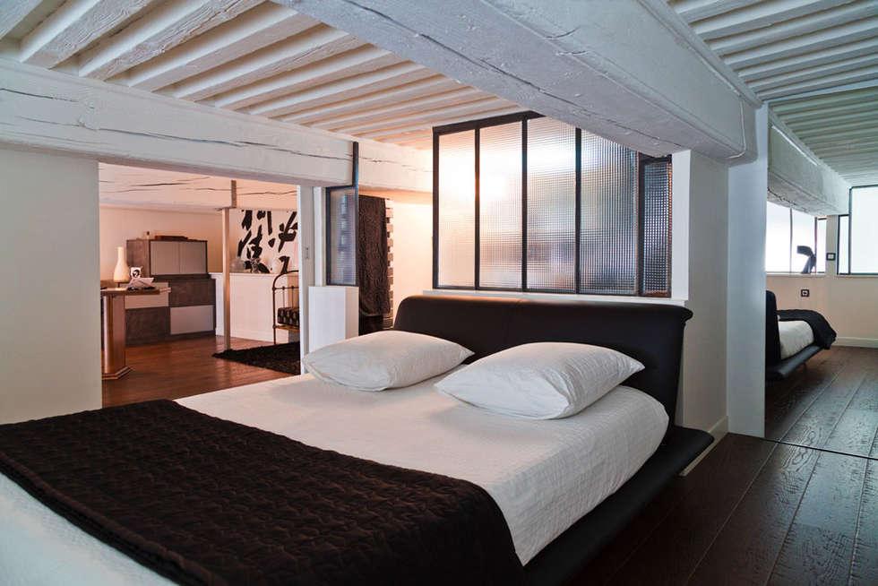 Rénovation d'un appartement de canut en duplex à Lyon Croix Rousse: Chambre de style de style Industriel par Stellati Rénovation