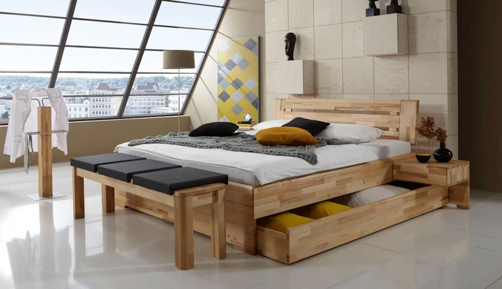 Dormitorios de estilo clásico por Massive Naturmöbel