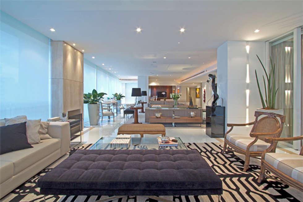 sofisticação: Salas de estar modernas por Jóia Bergamo - Arquitetura e Design de Interiores