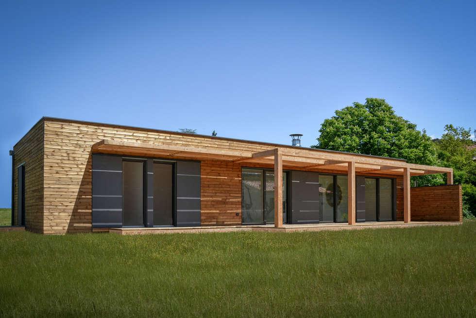 Maison bois moderne: Maisons de style de style Moderne par SARL naturARCH