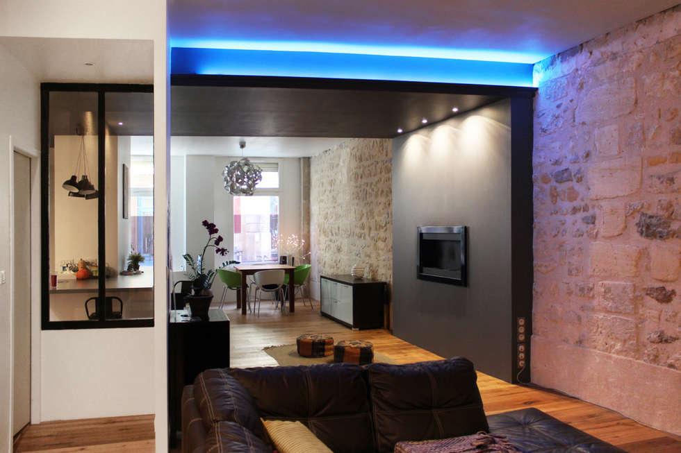Enfilade des espaces: Salle à manger de style de style Moderne par BIENSÜR Architecture