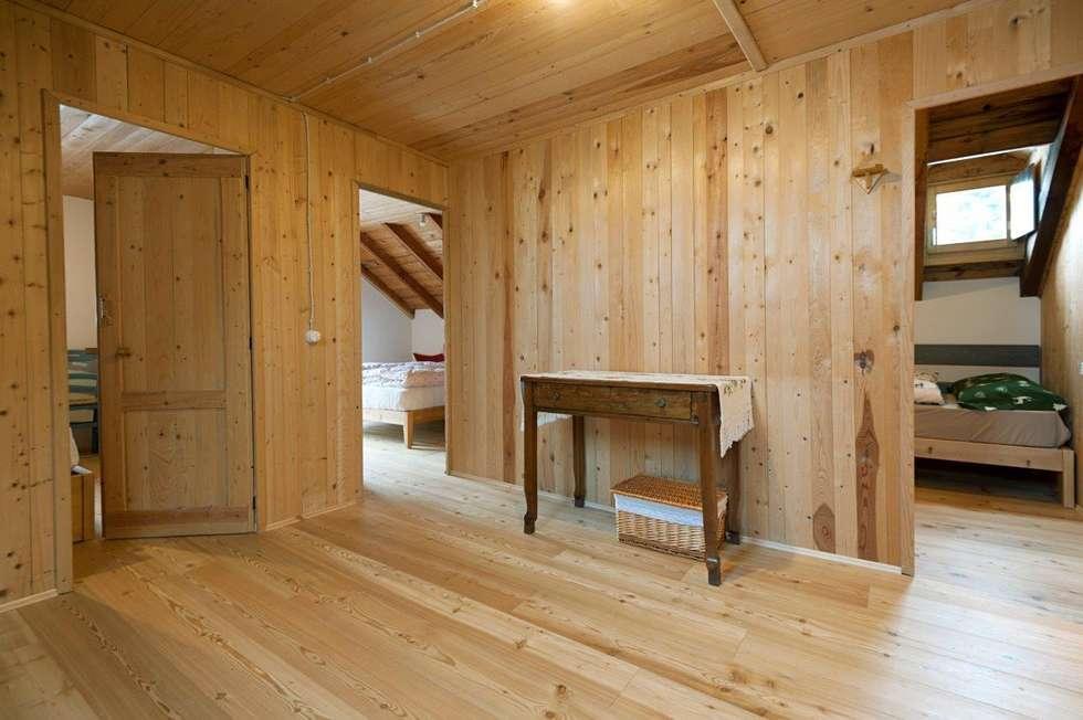 Primo piano: Case in stile in stile Rustico di Parchettificio Garbelotto Srl -  Master Floor Srl