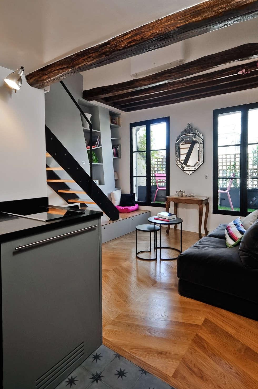 Salon - vue sur terrasse: Salon de style de style Moderne par Marion Rocher