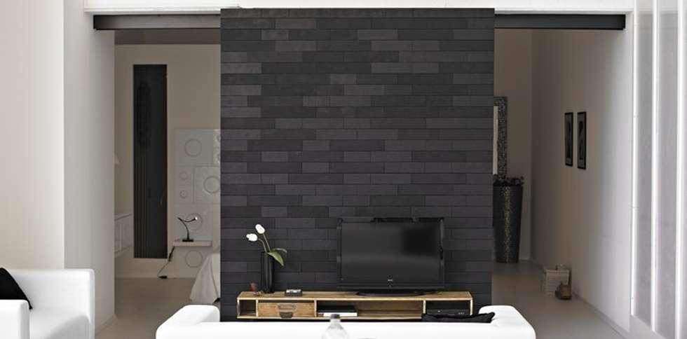 The Loft - parete divisoria: Sala da pranzo in stile in stile Moderno di D.I. Più s.r.l - Andretto Design