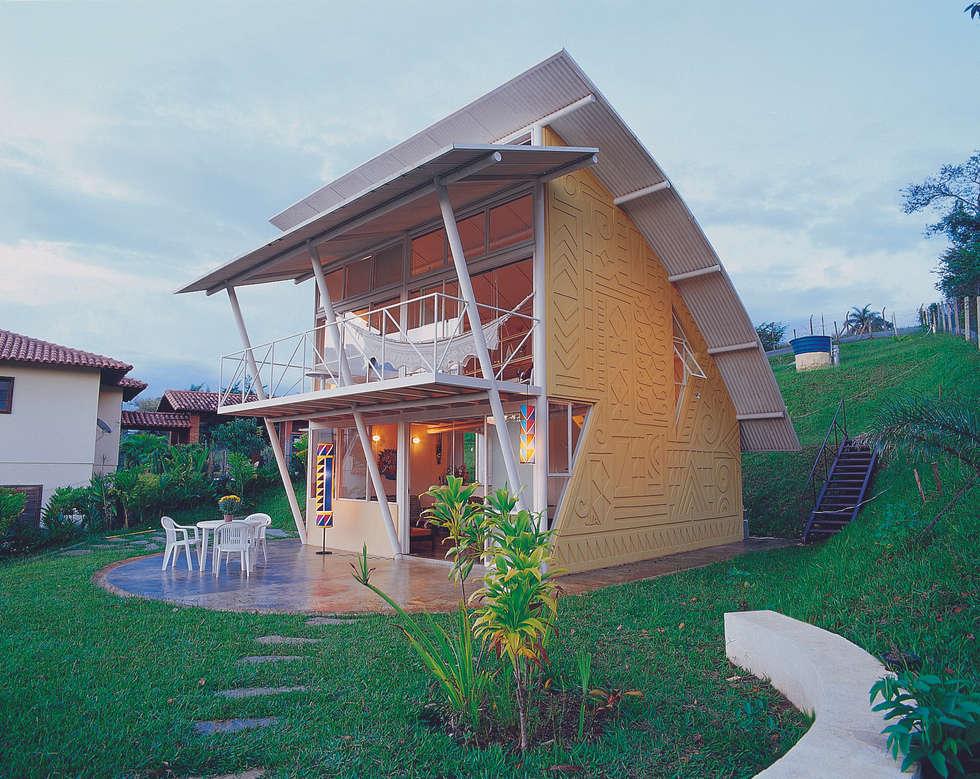 Projekty, nowoczesne Domy zaprojektowane przez JOAO DINIZ ARQUITETURA
