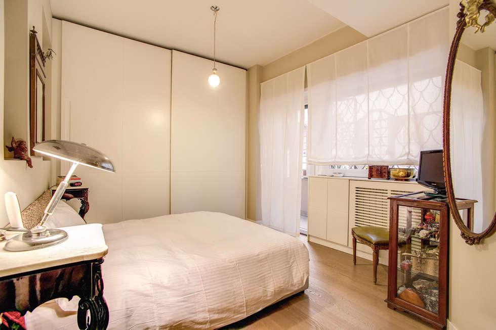 BALDUINA#2: Camera da letto in stile in stile Moderno di MOB ARCHITECTS