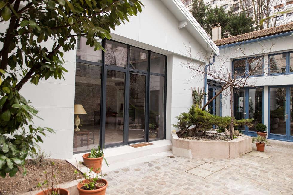 Façade après travaux: Maisons de style de style Moderne par Lise Compain